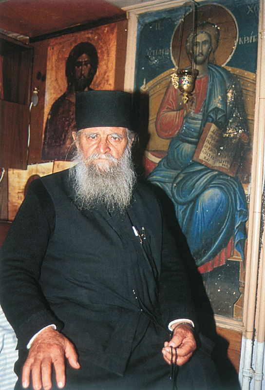 Father Charalambos of Dionysiou Monastery in his last cell, which St. Nephon, Patriarch of Constantinople, had once occupied when he was still a monk at the monastery. According to tradition, the Lord Himself appeared to the saint before the fresco of Christ while he was at prayer.