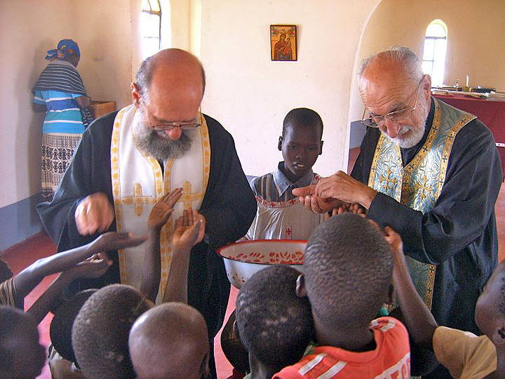 Fr-Vladimir-and-Fr-Michael-distribute-antidoron