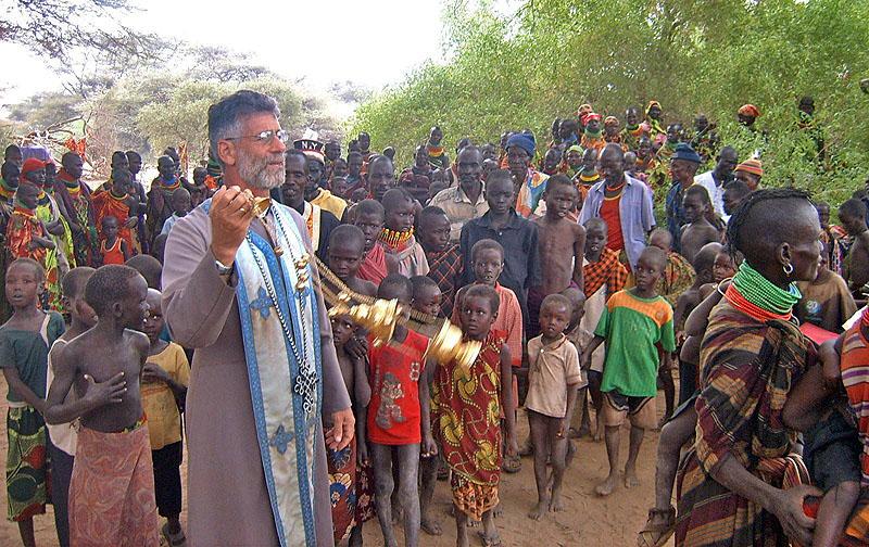 fr-martin-leads-procession-of-newly-baptized-Turkana